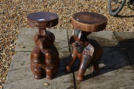 Two carved hardwood 'elephant' stools with circular seats