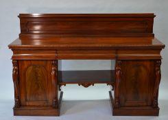 A Victorian mahogany twin pedestal sideboard