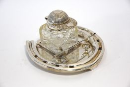 A Victorian electroplated inkstand modelled as a horseshoe