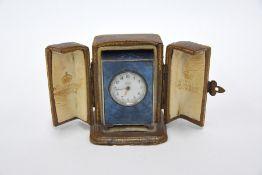 Asprey retailed enamel miniature travel clock