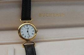 A Lady's Bucherer wristwatch, with a white dial and Roman numerals on a leather strap,