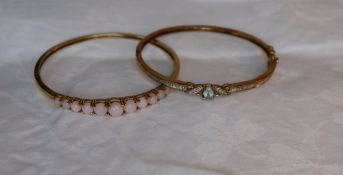 Two 9ct yellow gold semi precious gem set hinged bangles, approximately 16.