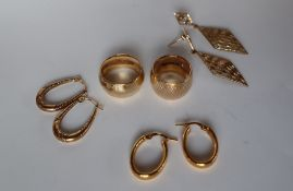 Two 9ct yellow gold wedding bands together with three pairs of 9ct gold earrings, approximately 19.