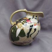 """A Moorcroft pottery jug, decorated in the """"Pigalle"""" pattern,"""