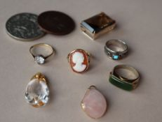A shell cameo ring, together with other rings,