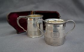A George IV silver christening mug, of tapering baluster form with line decoration, London, 1823,