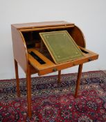 An Edwardian satinwood bureau with cylinder tambour and pull out writing surface fitted with