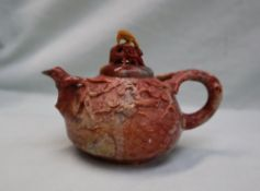 A Chinese carved soapstone teapot, the lid decorated with an eagle,