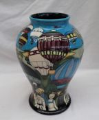 """A Moorcroft pottery vase of inverted baluster form decorated in the """"Up up and away"""" pattern,"""