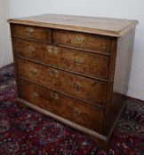 A Queen Anne walnut and cross banded chest, the rectangular moulded top,