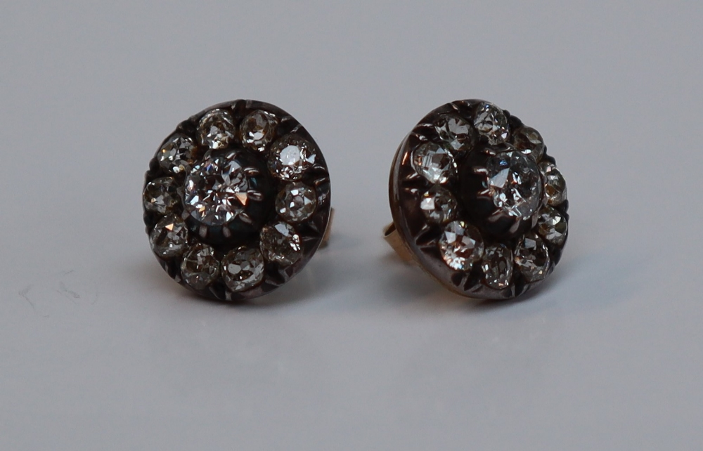 Lot 2 - A pair of diamond cluster earrings, set with a central old round cut diamond approximately 0.