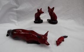 A large Charles Noke for Royal Doulton flambe stalking fox, printed marks, 32cm long,