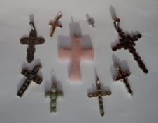 A rose quartz cross pendant together with a 9ct gold semi precious stone set crucifix and other