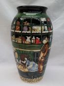 """A Moorcroft vase, decorated in the """"Little shop"""" pattern, limited edition no."""