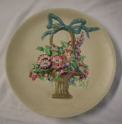 A Clarice Cliff pottery charger, moulded with a vase of flowers, printed mark,