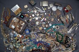 A large quantity of costume jewellery including necklaces, earrings, brooches, watches,