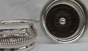 A pair of silver plated on copper bottle coasters,