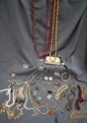 Assorted costume jewellery including beaded necklaces, watch,