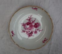 A Meissen porcelain shallow dish, with a gilt rim,