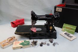 A Singer Model 222K featherweight convertible portable sewing machine, cased together with bobbins,