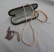 A pearl necklace, with one hundred and ten graduated pearls to a white metal clasp stamped 750,