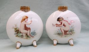 A pair of Mintons porcelain moon flasks painted with a boy chasing a butterfly,
