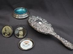 An Edwardian silver backed hand mirror, embossed with scrolling leaves, Sheffield, 1902,