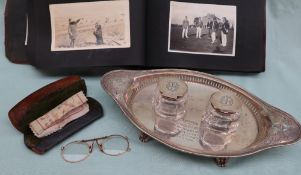 An Edward VII silver desk standish, of oval form, with vase pierced handles,