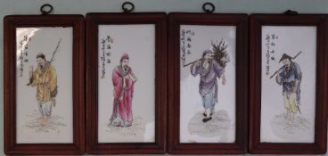 A set of four Chinese porcelain panels depicting figures in traditional dress, 24 x 11.