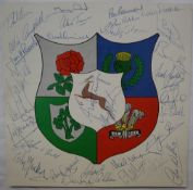 A 1980 signed British Lions to South Africa sheet with central badge signed by thirty team members