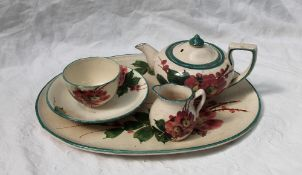 A Llanelly Art Pottery part cabaret set, comprising an oval tray, teapot, cream jug,