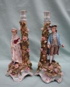 A pair of late 19th century Dresden candelabra (adapted) in the form of an 18th century style
