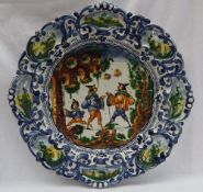An Italian Maiolica istoriato type charger, of shaped circular form,