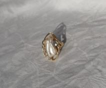 A pearl and diamond ring,