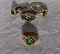 An emerald ring set in yellow metal together with a 9ct gold emerald set ring and two other rings