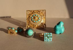 A dress ring, set with twenty five turquoise beads to a yellow metal setting and shank,