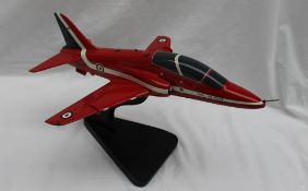 A Bravo Delta model of a BAE hawk T1 Red Arrows model, on a stand,