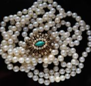 A three strand pearl necklace, set with individually knotted regular pearls each approximately 7mm,