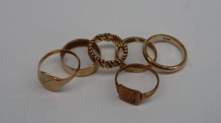 A 9ct gold signet ring together with five other 9ct gold rings,