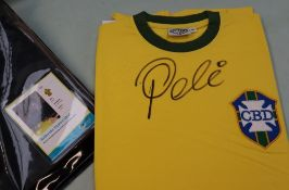 A replica Brazilian football shirt signed by Pele,