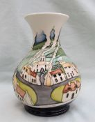 A Moorcroft pottery vase with a flared neck and baluster body decorated in the Sneem pattern,