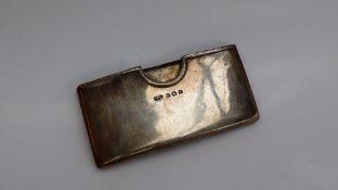 A George VI silver card case of bowed form, Birmingham, 1945, Jones & Crompton,