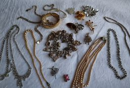 Assorted costume jewellery including bangles, necklaces, charm bracelet,