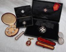 An Order of St John white metal and enamel medal, cased together with a matching miniature, cased,