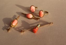 A 9ct yellow gold bar brooch, set with a coral hand with gold turquoise set cuff,
