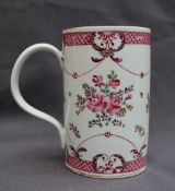 A 19th century Chinese Famille Rose porcelain tankard, decorated with flowers, leaves and swags, 14.
