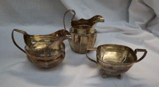 A George III Irish silver milk jug, marks indistinct, together with another Irish silver milk jug,