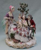 A 19th century Berlin porcelain figure group, depicting a family scene with a toddler,