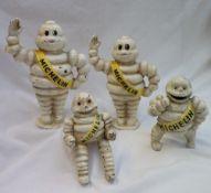 A set of four Michelin Man (Bibendum) cast iron money boxes,
