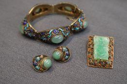 A Chinese white metal, jade and enamel panel bracelet,